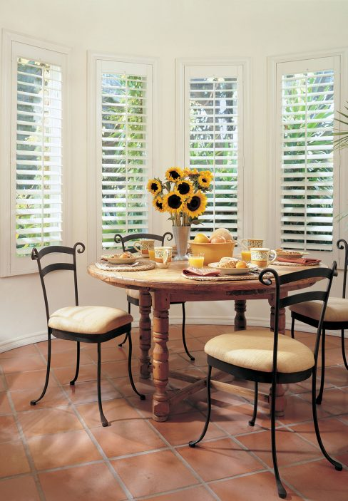 Eating Area with White Wooden Blinds and Sunflowers | Amy's Blinds on Marco Island, Florida